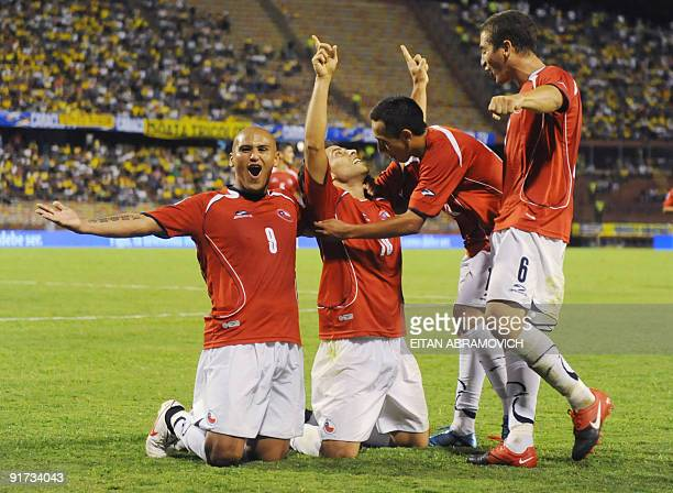 Chile's players Humberto Suazo and Carlos Carmona celebrate with others teammates after their victory against Colombia 2-4 in their FIFA World Cup...