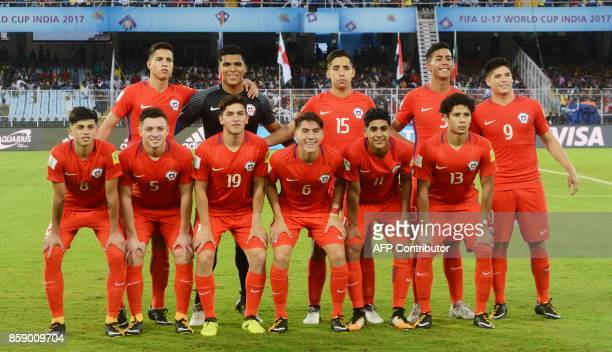 Chile's players pose for a group photograph before the football match between England and Chile in the FIFA U17 World Cup at the Salt Lake Stadium in...