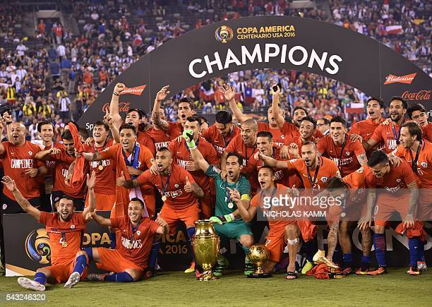 TOPSHOT Chile's players pose with the trophy after winning the Copa America Centenario final by defeating Argentina in the penalty shootout in East...