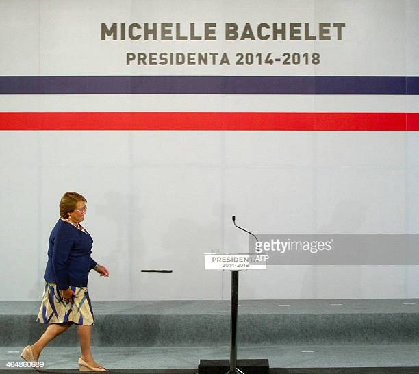 Chile's president elect Michelle Bachelet heads for the dais on January 24 during a ceremony to announce her cabinet AFP PHOTO/CLAUDIO REYES