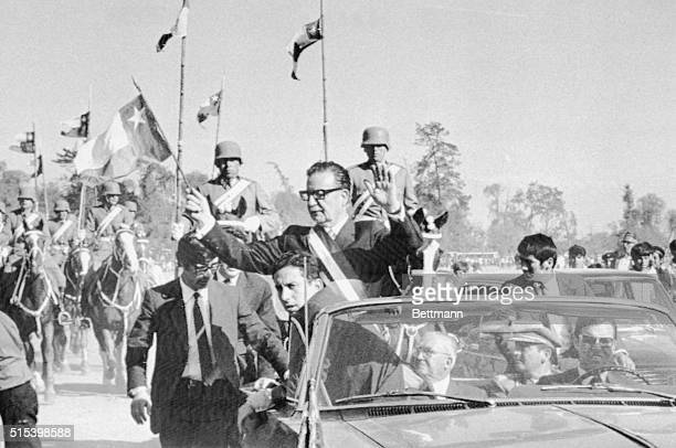 Chile's President Marxist Salvador Allende waves to the crowd en route to a military parade The bodyguards surrounding Allende were chosen from party...