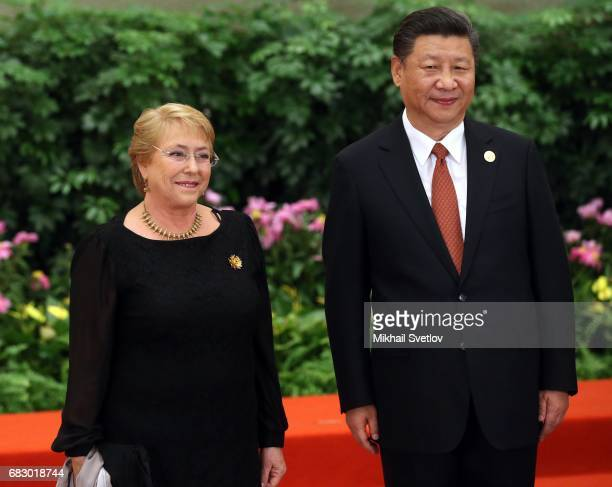 Chile's President Michelle Bachelet and Chinese President XI Jinping pose for a photo prior to the dinner during the Belt and Road Forum for...