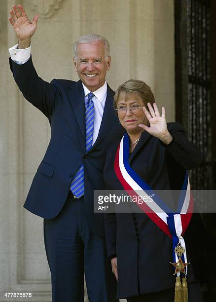 Chile's President Michelle Bachelet and US Vice President Joe Biden wave at the press in Vina Del Mar Chile on March 11 2014 after Chilean President...