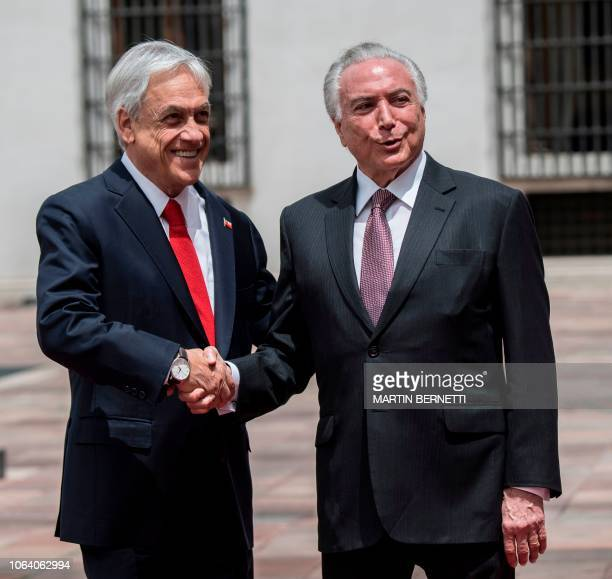 Chile's President Sebastian Pinera receives his Brazilian counterpart Michel Temer in Santiago to sign a free trade agreement between both countries...