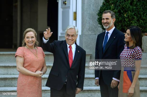 Chile's president Sebastian Pinera waves as he poses with his wife Cecilia Morel and Spanish monarchs Felipe VI and Letizia at La Zarzuela palace in...