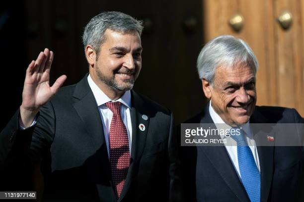 Chile's President Sebastian Pinera welcomes his Paraguayan counterpart Mario Abdo Benitez at La Moneda presidential palace in Santiago where they...