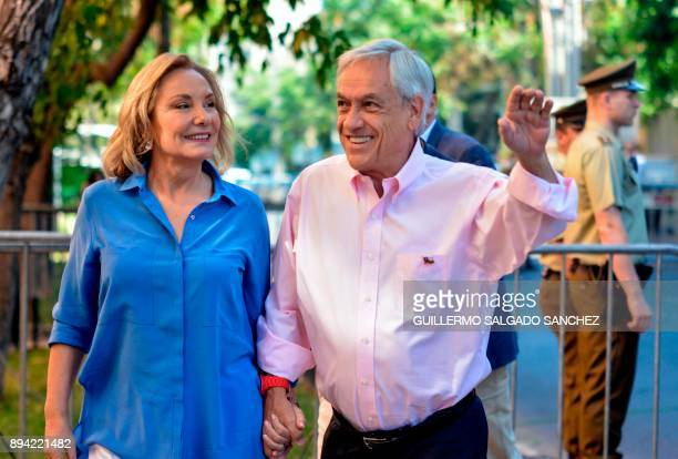 Chile's presidential candidate Sebastian Pinera and his wife Cecilia Morel wave during the presidential runoff election in Santiago Chile on December...