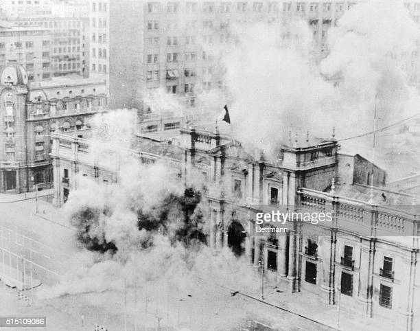 Chile's Presidential Palace burns at the height of bombardment during the coup d'etat by the nation's armed forces September 11