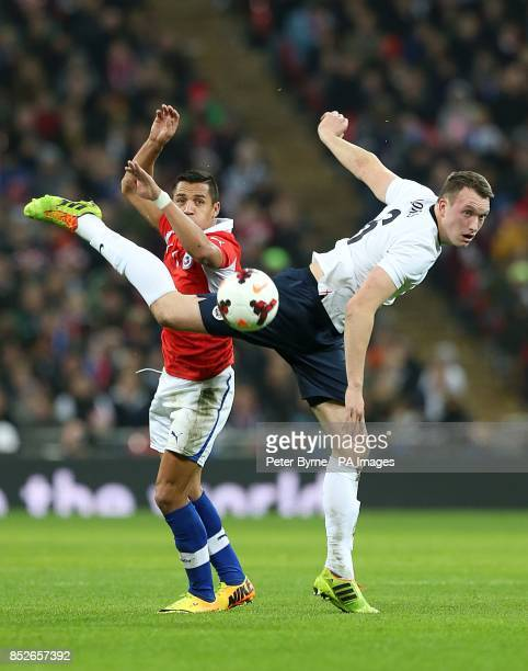 Chile's Sanchez Alexis and England's Phil Jones battle for the ball