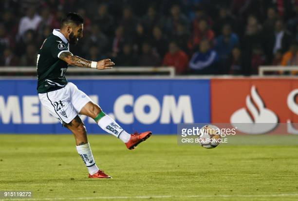 Chile's Santiago Wanderers player Marco Medel shoots to effectively score against Peru's Melgar during their Copa Libertadores football match at UNSA...