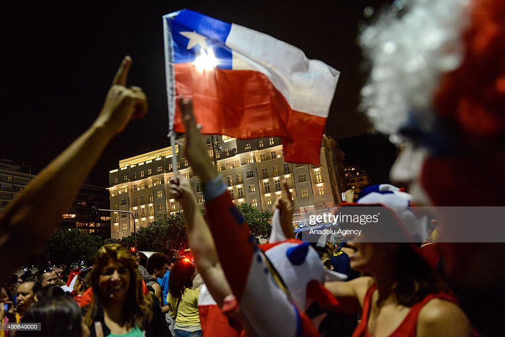 Chile's soccer fans celebrate their national team's victory over Spain within the 2014 FIFA World Cup Group B match at the Copacabana beach in Rio de Janeiro, Brazil, on June 18, 2014.