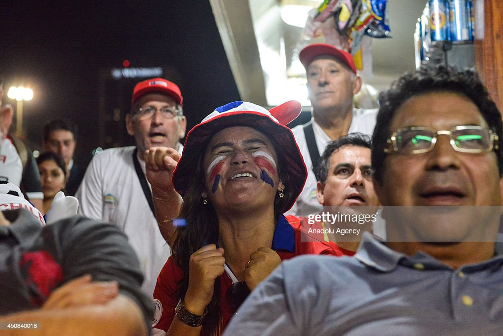 Chile's soccer fans watch their national team match against Spain within the 2014 FIFA World Cup Group B match at the Copacabana beach in Rio de Janeiro, Brazil, on June 18, 2014.