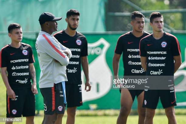 Chile's Under23 football team coach Bernardo Redin gives instructions to his players players Pablo Aranguiz Franco Lobos Ivan Morales and Thomas...