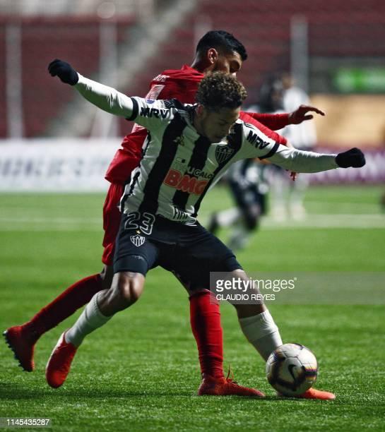 Chile's Union La Calera player Franco Lobos vies for the ball with Brazil's Atletico Mineiro footballer Guga during a Copa Sudamericana football...