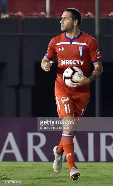 Chile's Universidad Catolica Luciano Aued celebrates after scoring against Paraguay's Libertad during their Copa Libertadores football match at the...