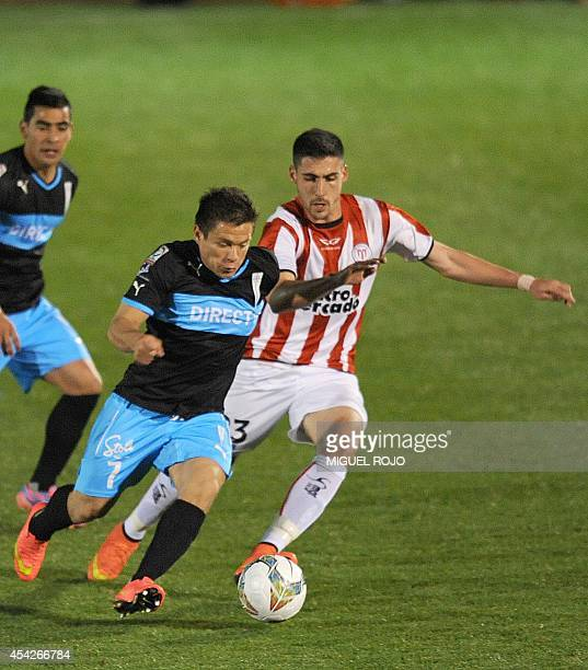 Chile's Universidad Catolica player Alvaro Ramos vies for the ball with Uruguay's River Plate player Claudio Innella during their Copa Sudamericana...