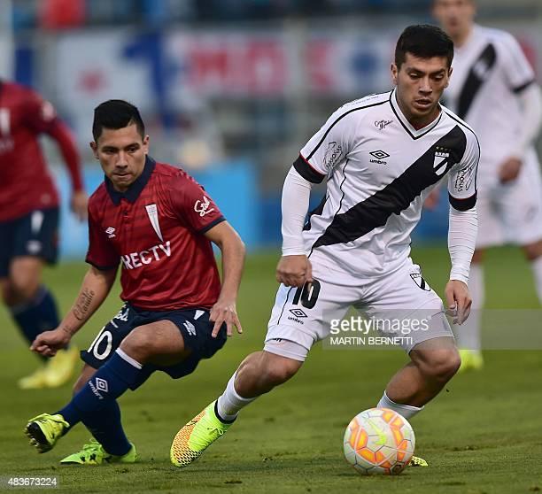 Chile's Universidad Catolica player Diego Rojas vies for the ball with Uruguay's Danubio player Ignacio Gonzalez during their Copa Sudamericana...