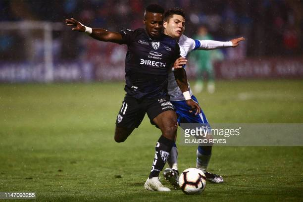 Chile«s Universidad Catolica player Juan Cornejo vies for the ball with Ecuador's Independiente del Valle footballer Cristian Dajome during their...
