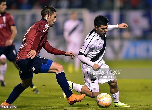 Chile's Universidad Catolica's player German Lanaro vies for the ball with Uruguay's Danubio's player Ignacio Gonzalez during their Copa Sudamericana...