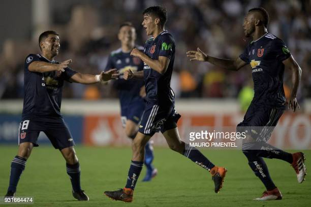 Chile's Universidad de Chile player Angelo Araos celebrates with teammates after scoring a goal against Brazil's Vasco da Gama during 2018...