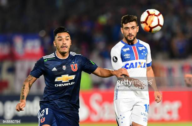 Chile's Universidad de Chile player Lorenzo Reyes vies for the ball with Brazil's Cruzeiro Uruguayan footballer Giorgian De Arrascaeta during their...