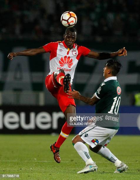 Chile's Wanderers player Enzo Gutierrez vies for the ball with Colombia's Independiente Santa Fe player Baldomero Perlaza during their 2018 Copa...