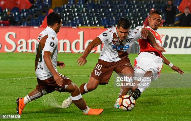 Chile's Wanderers player Enzo Gutierrez vies for the ball with Colombia's Santa Fe player William Tesillo during their 2018 Copa Libertadores...