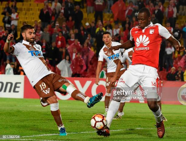 Chile's Wanderers player Ezequiel Luna vies for the ball with Colombia's Santa Fe player Baldomero Perlaza during their Copa Libertadores football...