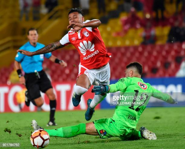 Chile's Wanderers player Mauricio Viana vies for the ball with Colombia's Santa Fe player Wilson Morelo during their Copa Libertadores football match...