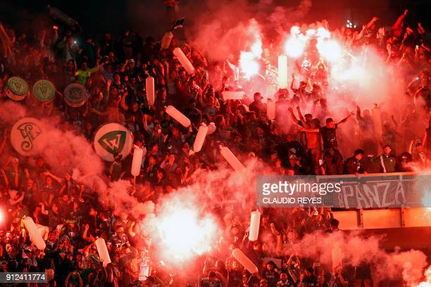 Chile's Wanderers supporters light flares during their 2018 Copa Libertadores football match against Peru's Melgar at the Elias Figueroa stadium in...