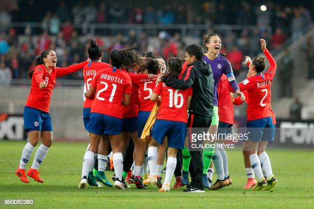 Chile's women's National football team players celebrate after defeating Argentina's and coming in Second place in the Women's Copa America match at...