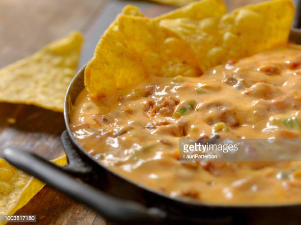 chili cheese dip - chili pepper stock pictures, royalty-free photos & images