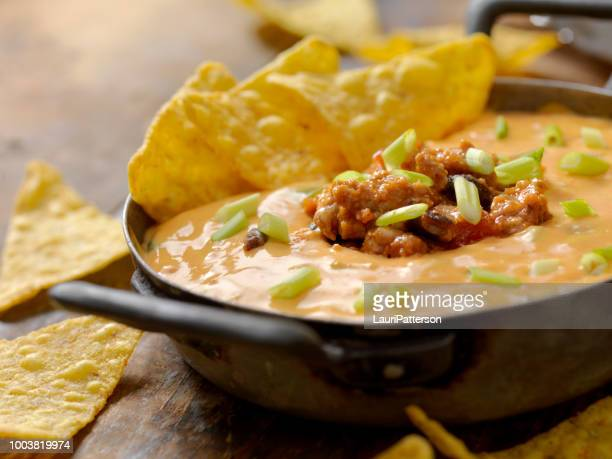 chili cheese dip - cheese sauce stock photos and pictures