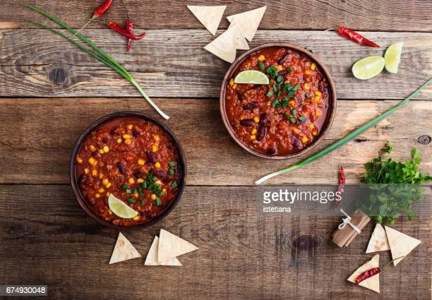 chili con carne stew served in ceramic bowll - chili stock photos and pictures