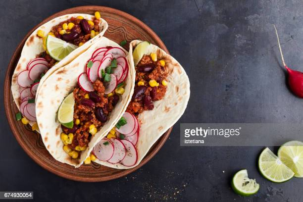 Chili con carne tacos viewed from above