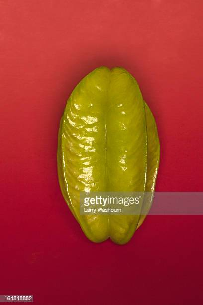 a chili pepper arranged suggestively to look like female genitalia - descrever imagens e fotografias de stock