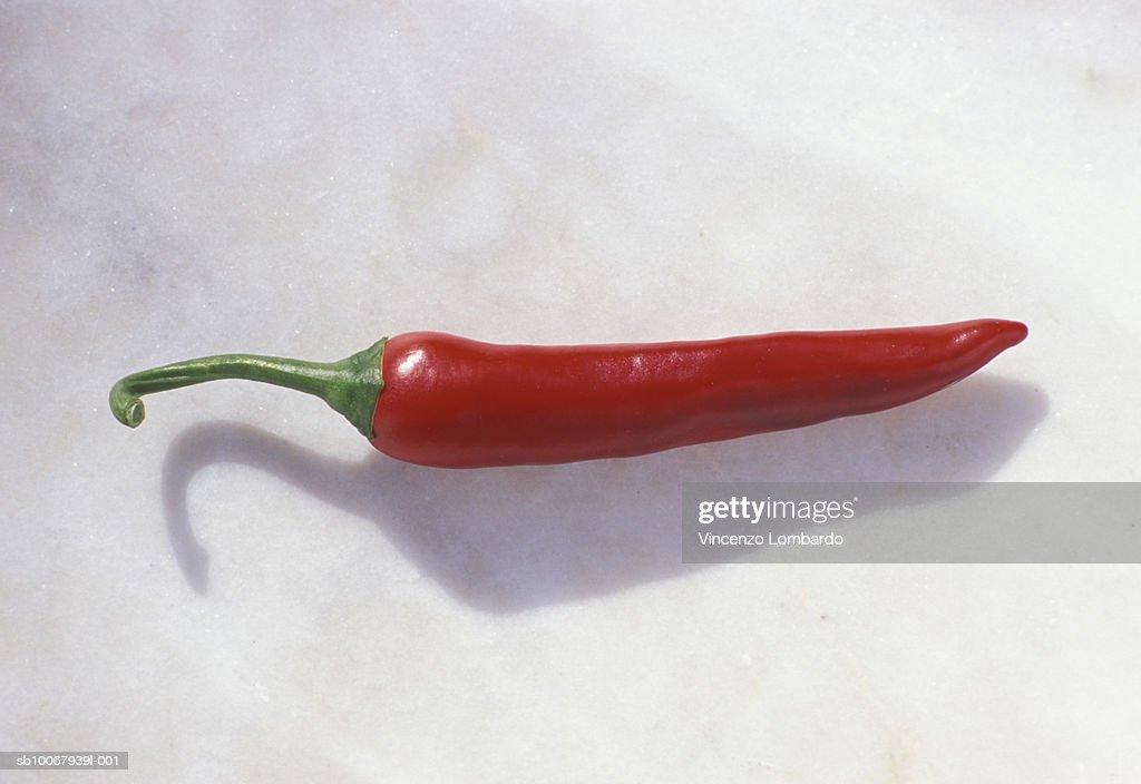 Chili pepper on white background, close up : Stock Photo