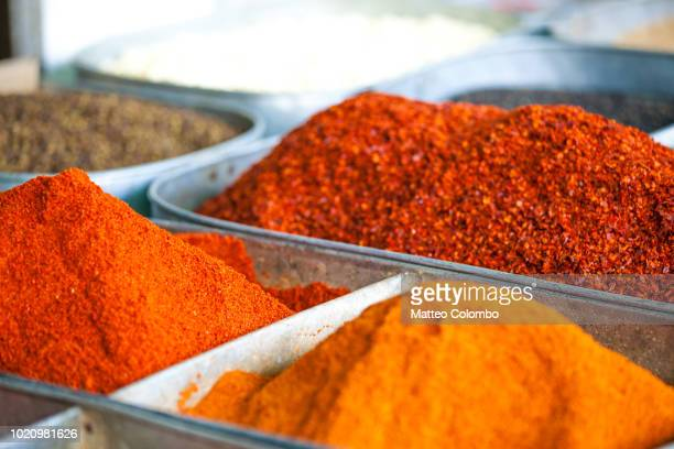 chili pepper powder for sale at local market - paprika stock pictures, royalty-free photos & images