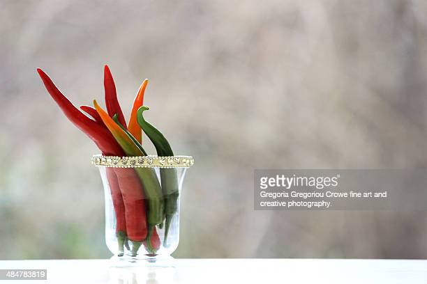 chili peppers in a glass - gregoria gregoriou crowe fine art and creative photography. stock photos and pictures