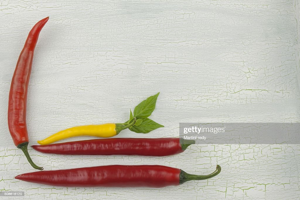 Chili peppers on white wooden platter. : Stock Photo