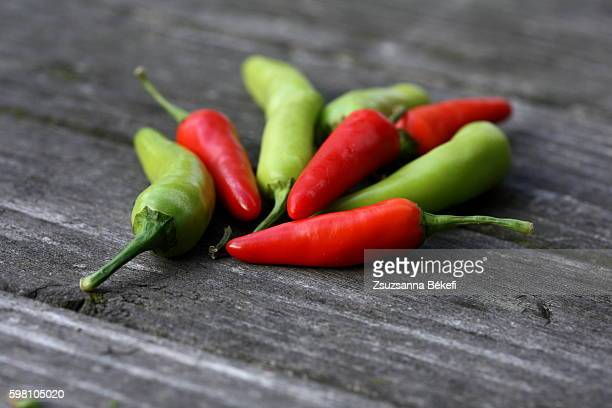 Chili peppers on wooden table