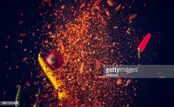 chili spice mix food explosion - chili stock photos and pictures