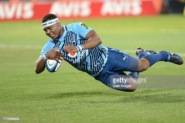 Chiliboy Ralepelle of the Bulls scores during the Super Rugby match between Vodacom Bulls and Southern Kings from Loftus Versfeld on June 29 2013 in...