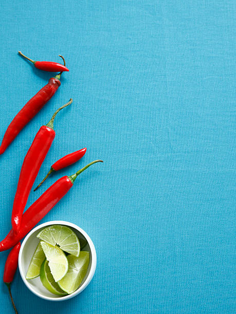 Chilis With Bowl Of Lime Wedges Wall Art