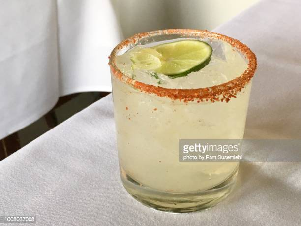 Chili-Salt Rimmed Paloma Cocktail on White Tablecloth