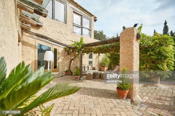 chill area in a mediterranean farmhouse backyard garden terrace - mediterranean culture stock pictures, royalty-free photos & images