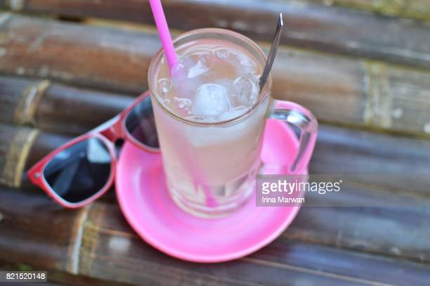 chilled coconut water - coconut water stock pictures, royalty-free photos & images