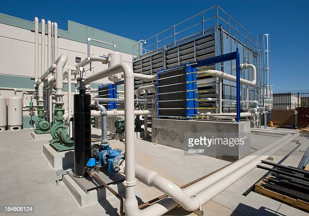 chiller tower with pumps. - cooling tower stock pictures, royalty-free photos & images
