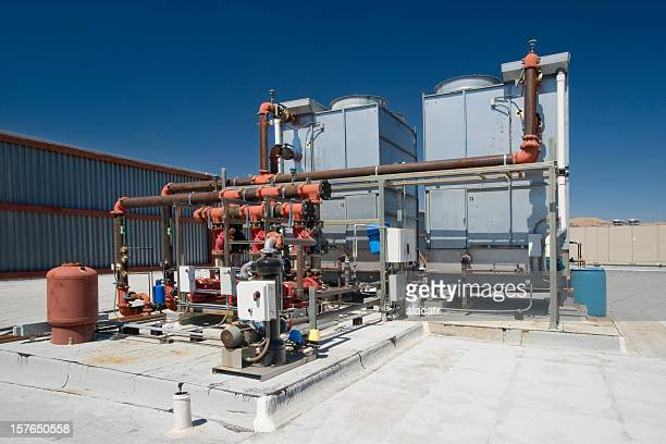 chiller towers and pumps - cooling tower stock pictures, royalty-free photos & images