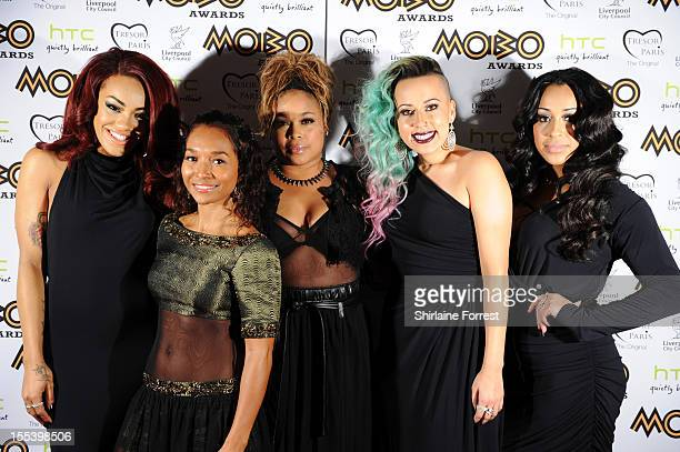 Chilli and TBoz of TLC pose with Karis Anderson Courtney Rumbold and Alexandra Buggs of Stoosh attend the 2012 MOBO awards at Echo Arena on November...